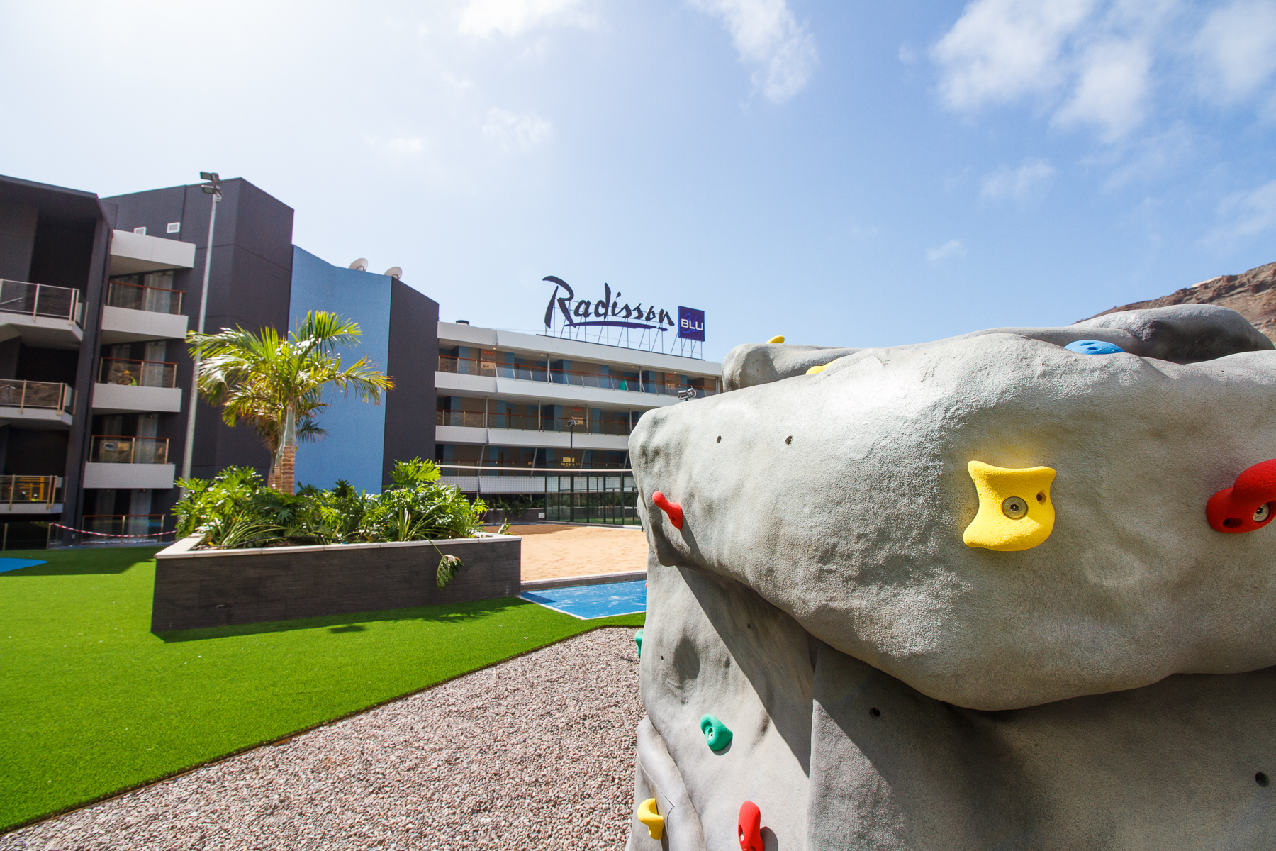 Radisson Blue climbing wall and beach volleyball court