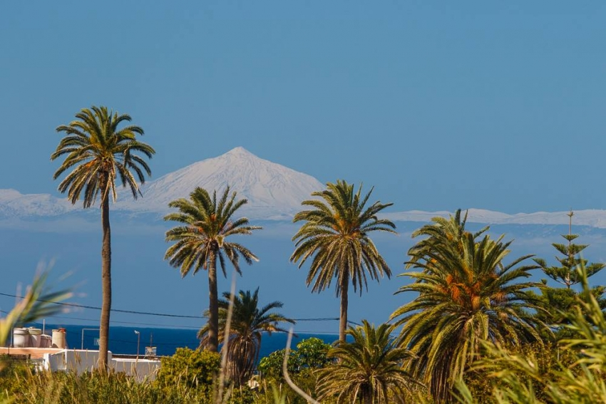 Teide volcano covered in snow as seen from Gran Canaria