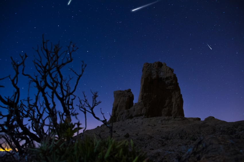 Perseid meteor shower over Roque Nublo in Gran Canaria